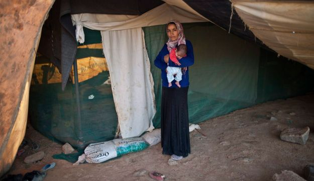 Khalida Moussa, 28, after giving birth to her child, Aug. 14, 2015