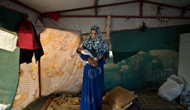 Feedah Ali, 18, after giving birth to her child, Aug. 16, 2015