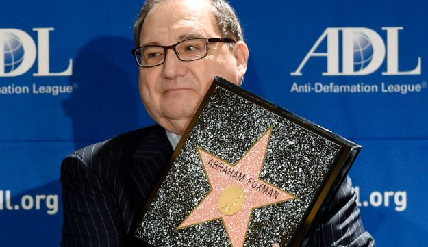 Abraham Foxman holding a replica of his Hollywood Walk of Fame Star