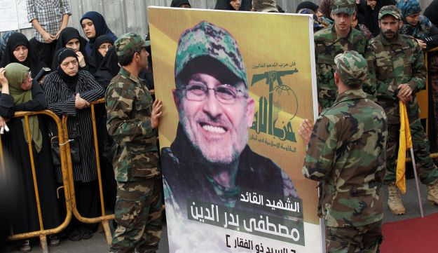 Members of Hezbollah carry a portrait of Mustafa Badreddine, a top commander killed in Syria, during his Beirut, May 13, 2016.