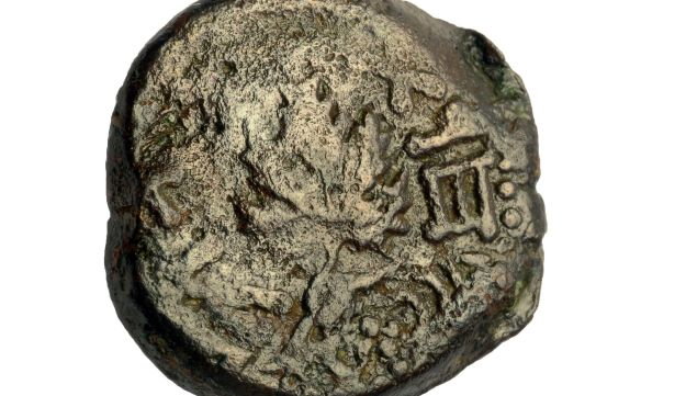 A coin from the Jewish Rebellion era, found in the rubble.