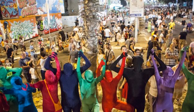 The Prizma Ensemble marched through the city streets dressed in colorful unitards