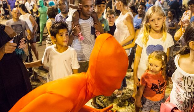 A woman, wearing her full solid-coloured, taking part in a street art performance in Bat Yam