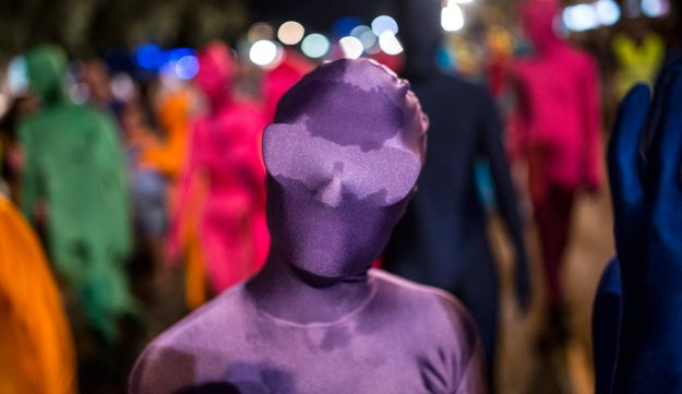 A woman, wearing her full solid-coloured, taking part in a street art performance in Bat Yam.