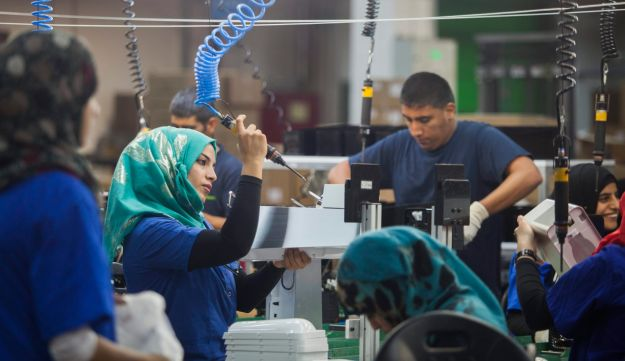 Employees work at the new SodaStream factory built deep in Israel's Negev Desert