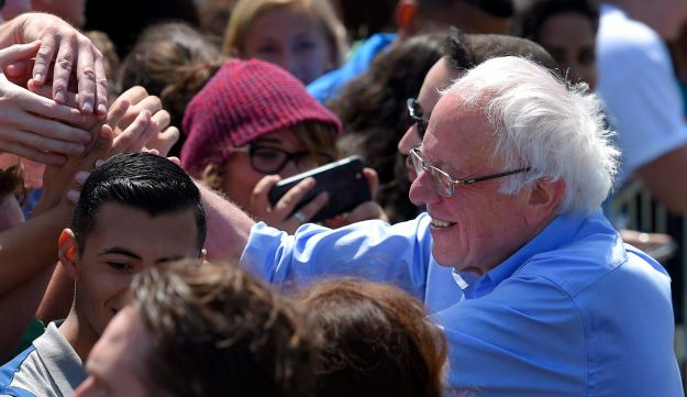 Democratic presidential candidate Sen. Bernie Sanders, right, greets supporters after speaking at a campaign rally, Saturday, May 28, 2016, in Santa Maria, California.