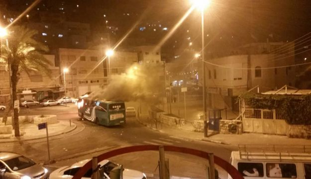Bus set ablaze, attacked with stones in East Jerusalem