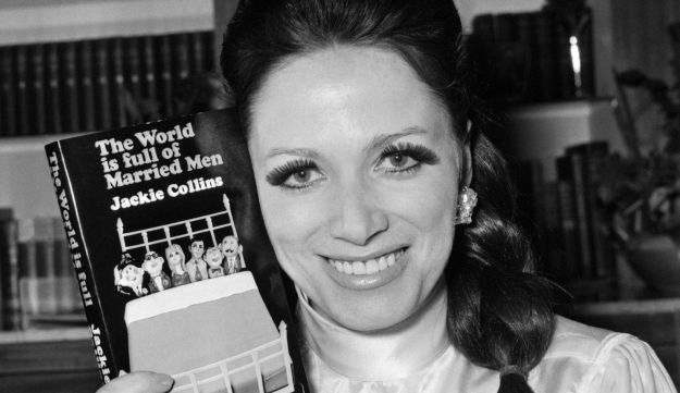 """Jackie Collins, sister of actress Joan Collins, holds her first book """"The World Is Full Of Married M"""