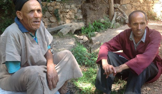 Etrog grower Mohammed Douch, left, with his cousin.