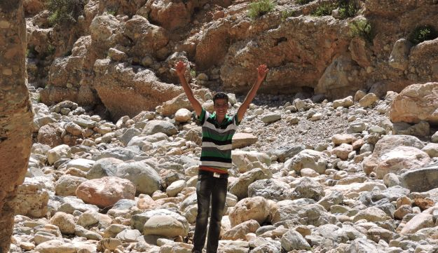 """JTA reporter Ben Sales' """"fixer,"""" Mohammed, experiencing a moment of triumph along the etrog trail."""