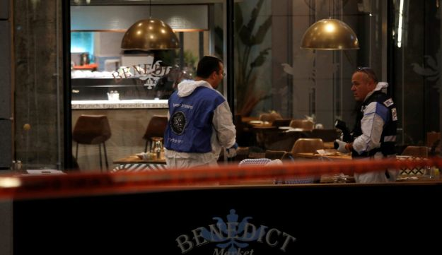 Israeli policemen work inside a restaurant following a shooting attack that took place in the center of Tel Aviv June 8, 2016.