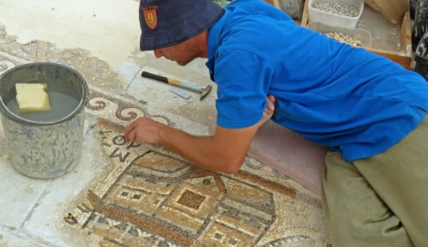 Workers of the Israel Antiquities Authority conserving the mosaic