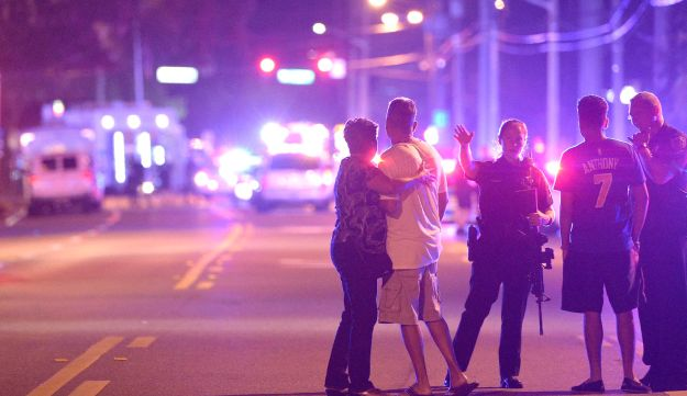 Orlando Police officers direct family members away from a multiple shooting at a nightclub in Orlando, Florida, June 12, 2016.