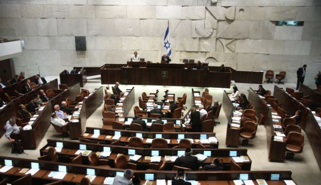 The Knesset plenum, with the wall designed by Dani Karavan behind the speaker's podium.