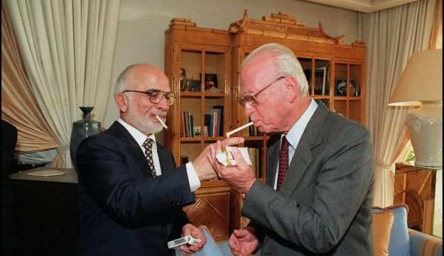 King Hussein of Jordan lights Prime Minister Yitzhak Rabin's cigarette