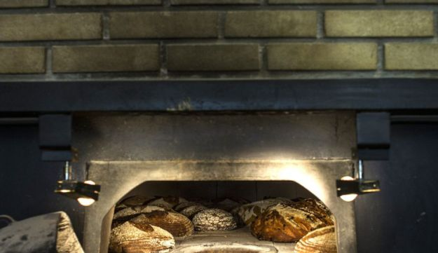 The wood-fired oven at the Tishbi Bakery produces splendid breads.