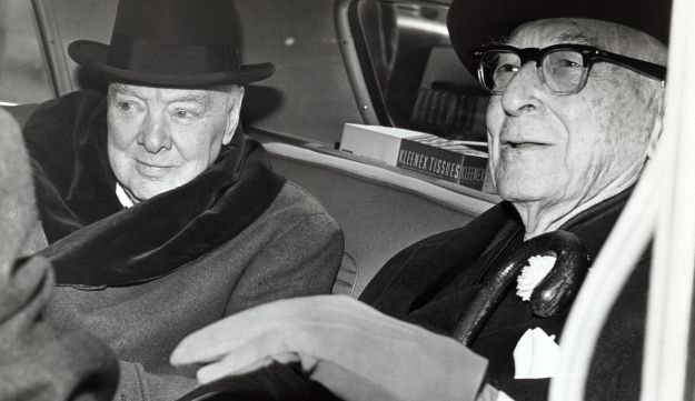 Sir Winston Churchill, British statesman, left, and Bernard Baruch, financier, converse in the back seat of a car in front of Baruch's home. April 14, 1961.