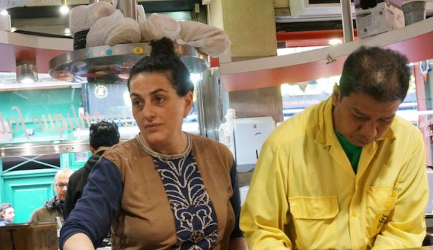 Martine Ouaknine, left, with an employee of her Mi-Va-Mi falafel shop in the historical Jewish quarter of Paris, May 18, 2016.