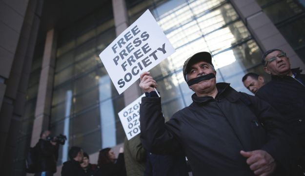 A Turkish journalist joins protests in Istanbul in an April 2016 trial of journalists accused of revealing state secrets.