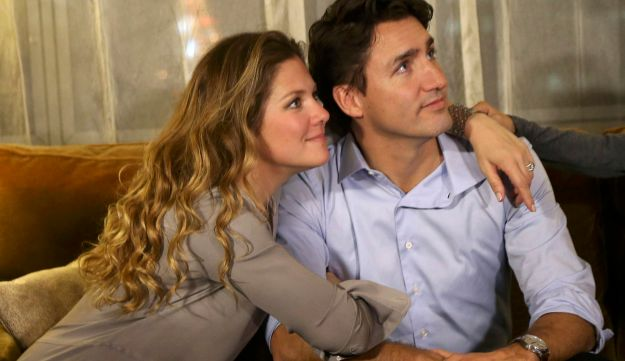 Liberal leader Justin Trudeau is embraced by his Wife Sophie Gregoire as he watches results at his e
