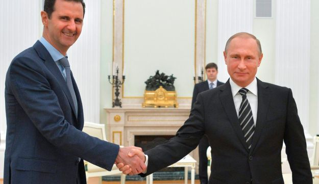 Putin shakes hand with Syria's Assad in the Kremlin in Moscow, Russia, October 21, 2015.