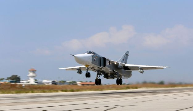 A Russian fighter jet takes off from a runway in Syria, October 3, 2015.