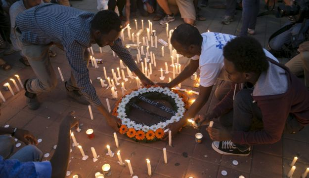 Israel's African migrant community holds a memorial for Haftom Zarhum, October 21, 2015.