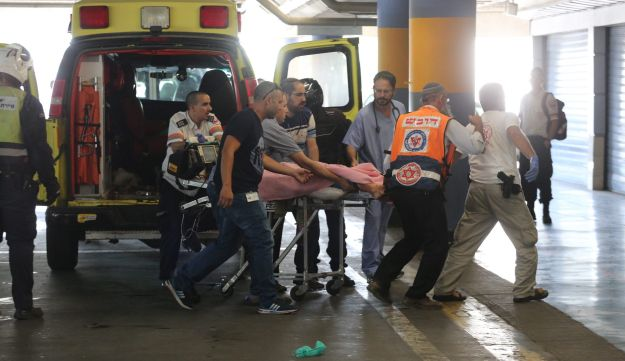 A victim of the attack in the Kiryat Arba settlement arrives at the hospital, June 30, 2016.