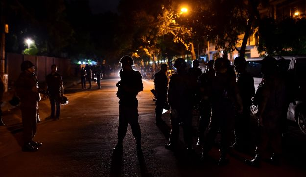 Bangladeshi security personnel stand guard after ISIS gunmen stormed a restaurant in Dhaka's diplomatic district, July 2, 2016.