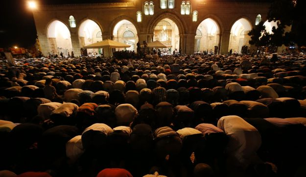 Muslim worshippers praying outside the Dome of the Rock in the Al-Aqsa Mosque compound on Laylat al-Qadr, Friday night.
