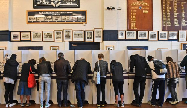 People vote at a voting station in the Sydney suburb of Bondi Beach on July 2, 2016.
