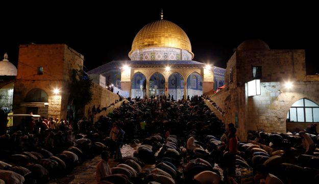 Muslim men pray during Laylat al-Qadr in fron   t of the Dome of the Rock during the Muslim holy month of Ramadan in Jerusalem's Old City July 1, 2016.