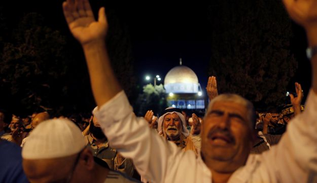 Muslim men pray during Laylat al-Qadr in front of the Dome of the Rock during the Muslim holy month of Ramadan in Jerusalem's Old City July 1, 2016.