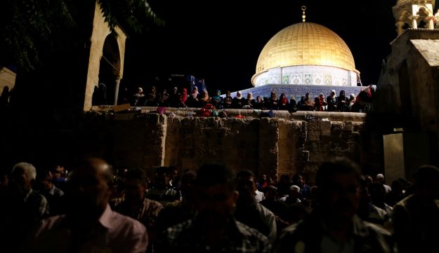 Muslims pray during Laylat al-Qadr in front of the Dome of the Rock, on the compound known to Muslims as al-Haram al-Sharif, and to Jews as Temple Mount during the Muslim holy month of Ramadan in Jerusalem's Old City July 1, 2016.