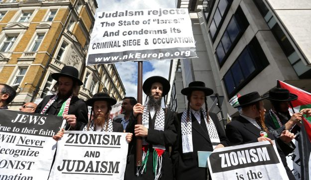 A group of anti-Zionist, ultra-Orthodox Jewish men participating in the al-Quds Day march in London on Sunduy.
