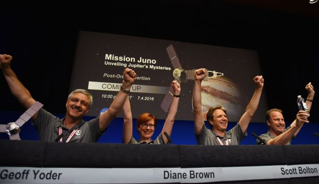 NASA officials celebrate at a press conference after the Juno spacecraft was successfully placed into Jupiter's orbit, at the Jet Propulsion Laboratory in Pasadena, California on July 4, 2016.