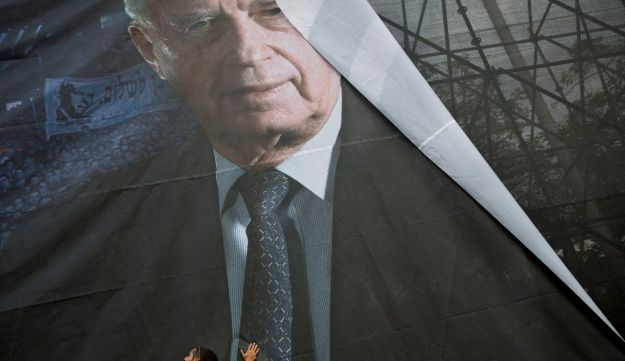 A photograph being mounted in Rabin Square for a commemorative rally, Oct. 25, 2015.
