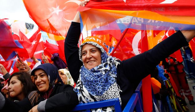 Supporters listen to Turkish Prime Minister Ahmet Davutoglu during a rally of his Justice and Develo