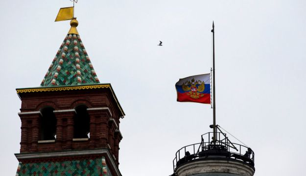 Russian national flag is flown at half-mast on top of the Senate Building in Kremlin on the day of