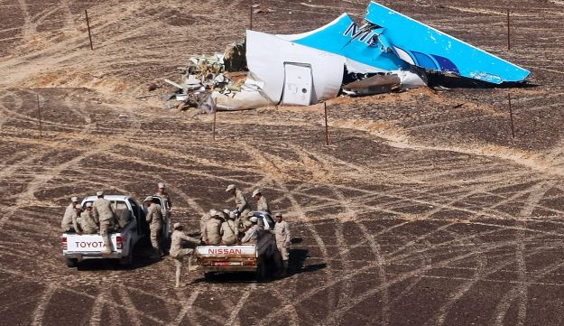 Egyptian Military cars approach tail of Russian plane crash in Sinai. November 2, 2015.