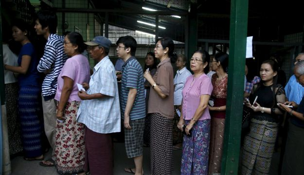 People line up to cast their votes at a polling station during Myanmar's general election in Yangon