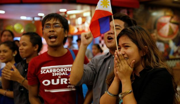 Activists react after a ruling on the South China Sea by an arbitration court in Hague, in favor of Philippines, in Manila, Philippines, July 12, 2016.