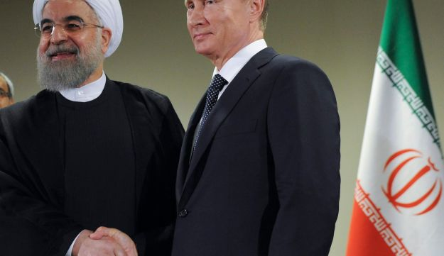 Russia's Vladimir Putin shakes hands with Iran's Hassan Rouhani after the 70th session of the United Nations General Assembly, New York, September 28, 2015.