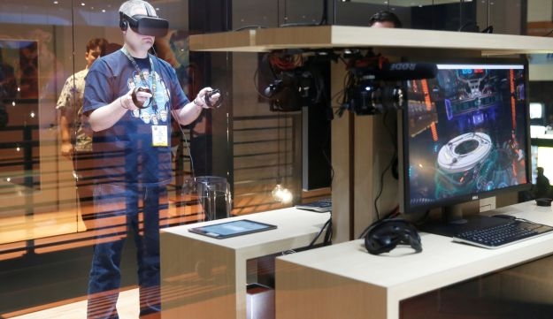 A man plays a frisbee throwing video game with the Oculus Rift VR headset at the E3 Electronic Expo in Los Angeles, California, U.S. June 14, 2016