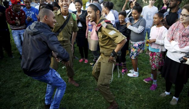 Members of the Ethiopian Jewish community in Israel dance during a ceremony marking the holiday of Sigd in Jerusalem November 11, 2015.
