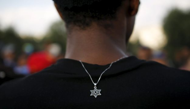 A member of the Ethiopian Jewish community in Israel wears a medallion with the Star of David as he takes part in a ceremony marking the holiday of Sigd in Jerusalem November 11, 2015.