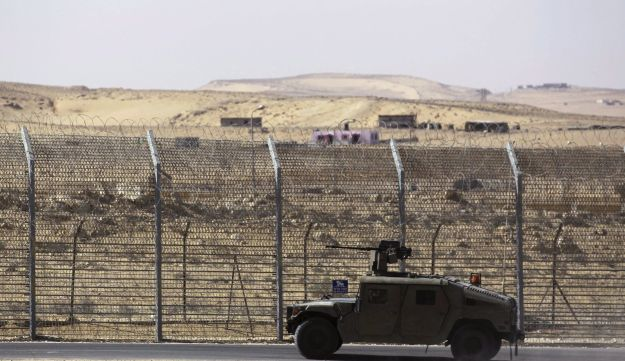 An armored Israeli military vehicle drives along Israel's border with the Sinai peninsula in Egypt. January 30, 2014.