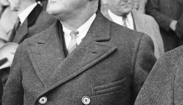 President Franklin D. Roosevelt appointed Felix Frankfurter to the Supreme Court, in 1939. This photograph shows the U.S. president, reportedly a rabid sports fan, watching a baseball game on April 17, 1935. His home team beat Philadelphia, 4-2.