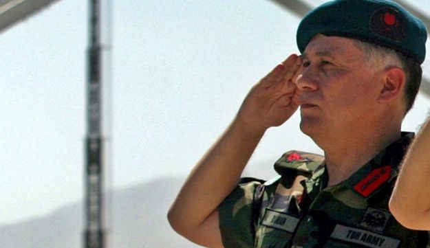 Turkish Brigadier General Umit Dundar salutes during a handover of command of the Kabul Multinational Brigade in Kabul, Afghanistan July 20, 2005.