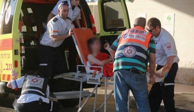 Paramedics evacuate a 16-year-old boy wounded in a shooting in the southern Hebron Hills, November 13, 2015..